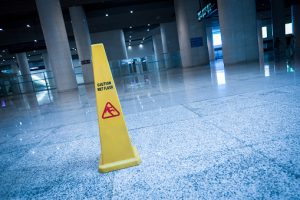 slippery sign on floor of modern building