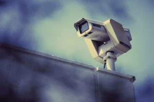 Surveillance camera on a wall